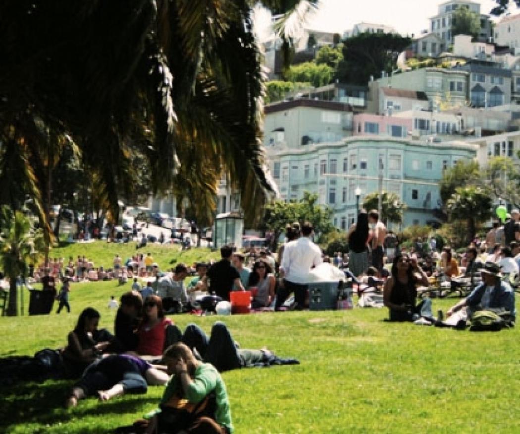 People sitting in a sunny Berkley park